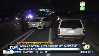 Woman hurt after crashing into parked vehicles