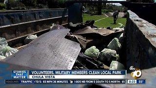Volunteers, military members clean local park