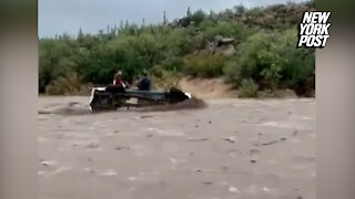 Bystanders Rescue Father and Son From Arizona Floodwaters