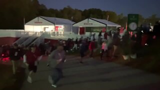 Fans rush to make it to first tee at Ryder Cup