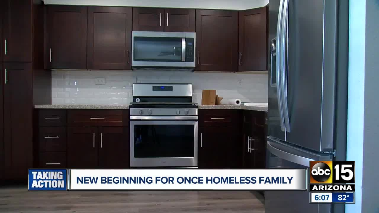 Valley homeless family gets keys to new apartment