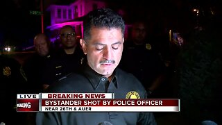 Milwaukee Police officer shoots at suspect, injures bystander