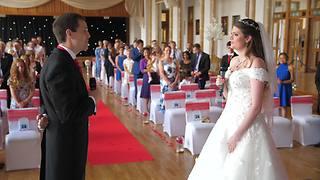 Bride And Groom Sing Duet Down Wedding Aisle