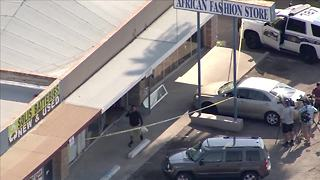 Four hospitalized after vehicle crashes into store