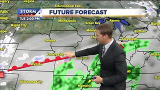Mostly cloudy Tuesday