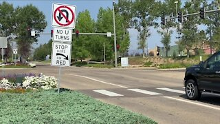 Why do drivers around Flatirons mall pull their car onto or beyond the crosswalk?