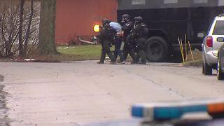 Barricaded gunman in custody after hours long standoff in Troy