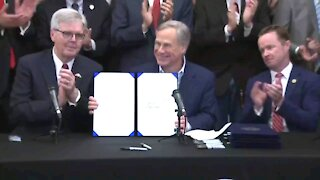 NEW - Texas Gov. Greg Abbott officially signs constitutional carry of guns into law.