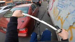 BMX'er wheelies his way through busy NY traffic!