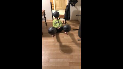Boy Spins Basketballs With Feet And Mouth