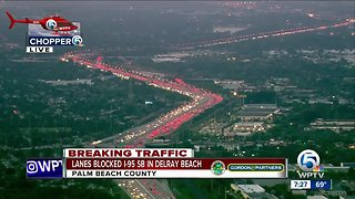 Semi wreck causing delays in southern Palm Beach County