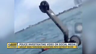 Police investigating group throwing scooters into Detroit River