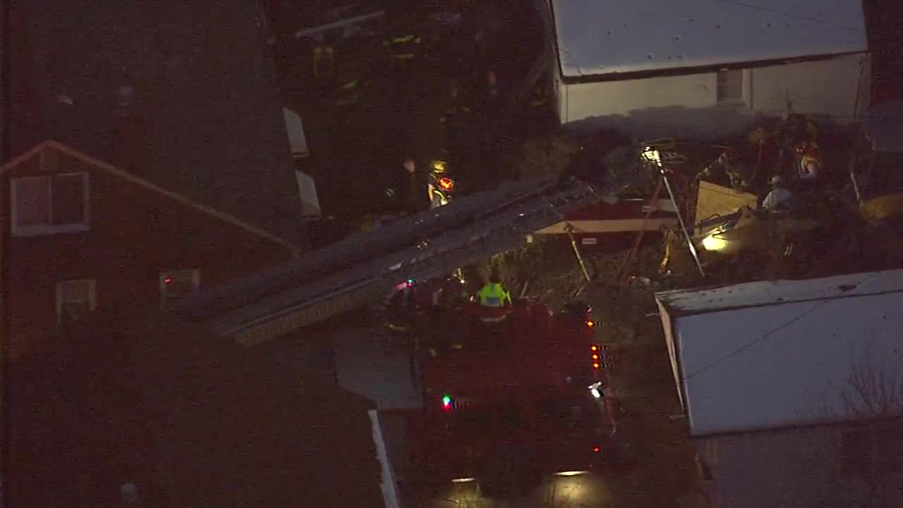 Crews try to rescue man from collapsed trench
