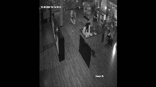 Hughes Defense surveillance video inside store