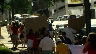 School officials, parents, and students rally in downtown Milwaukee for in-person learning