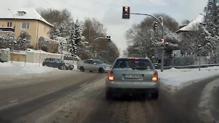 Lexus driver almost crashes into BMW after failed drift on an intersection