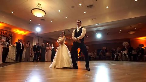 Bride And Groom Entertain Guests With Various Dance Techniques