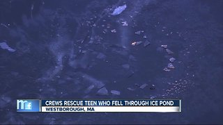 Boy rescued after falling through ice on frozen pond