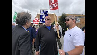 Sen. Sherrod Brown visits with striking workers at GM's Parma plant