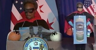 """Chicago Mayor Lightfoot Dresses As """"Rona Destroyer"""" At Press Briefing"""