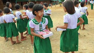 Distributing School Supplies and Uniforms to Refugee Kids