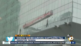 Window washer rescued after scaffolding slams into building