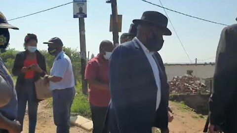 Cele speaks to a shopkeeper at the scene of the crime where an EFF candidate was gunned down