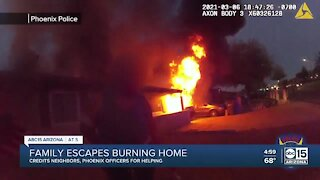 Must-see video: Phoenix police officers help rescue family from house fire