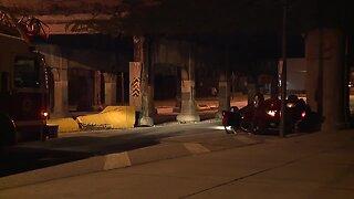 Driver hospitalized after car crashes into Superior Bridge
