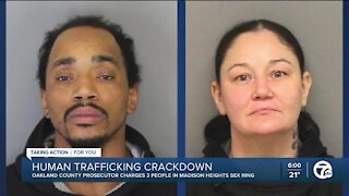 Two charged, one sought in Oakland County human trafficking case