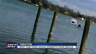 Police sergeant in kayak saves woman from sinking car in Detroit River