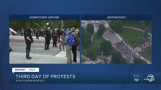 This was the scene at 8 p.m. as protestors filled the streets despite Denver curfew order