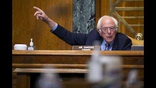 Senate Democrats Split on Spending Bill; Biden Meets Sanders
