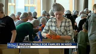 Packing meals for families in need at Nicolet High School