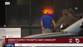 Armed suspect surrenders after Midway District standoff