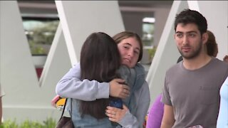 Family and friends gather at Reunification Center in Surfside