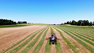 Drone footage shows beautiful views of farmers hard at work