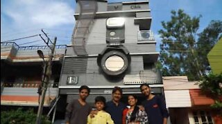 Photographer builds house to resemble camera
