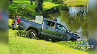 Driver dies at hospital after pickup truck sinks into pond