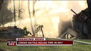 Crews battle house fire in NKY