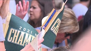 Bucks fans celebrate team's championship win during parade