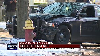 DPD officer injured after being hit by cruiser while escorting suspect across the street