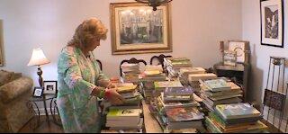 Jupiter woman supporting children, promoting literacy