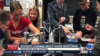 Students learning about water monitoring