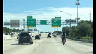 Biker rides for miles pulling wheelie