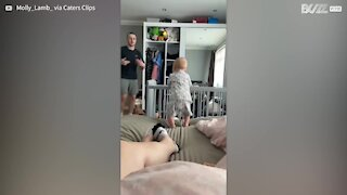 Baby copies father's dance moves!