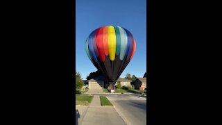 Hot air balloon lands in Omaha neighborhood (1/2)