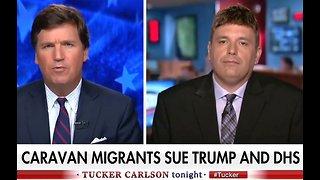 Tucker Carlson schools migrant caravan lawyer