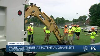 Work continues at potential grave site