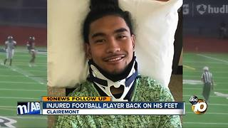 Injured football player back on his feet